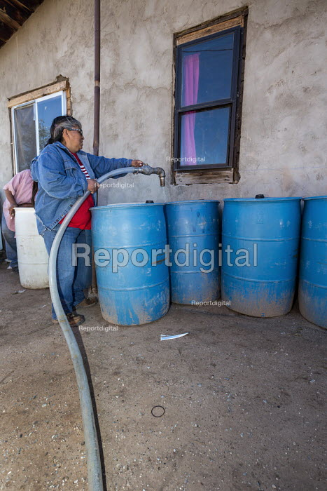 Thoreau, New Mexico, clean water being delivered by St. Bonaventure Indian Mission for a Navajo family. A third of the Navajo Nation lack a water supply in some places because past uranium mining has contaminated ground water. Relying on delivered water, these families use an average of 7-10 gallons a day, compared to 400 gallons for the typical American family of four. - Jim West - 2016-10-11