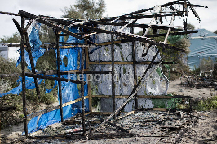 Burnt out remains after the eviction of refugees from the Jungle camp, Calais, France - Jess Hurd - 2016-10-27