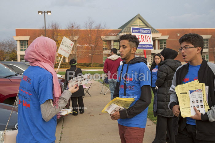 Michigan, USA 2016 Presidential election, American Arab & Muslim Political Action Committee (AAMPAC) campaigning for their candidates outside a polling station - Jim West - 2016-11-08