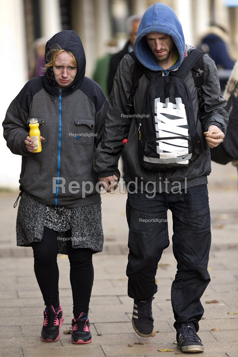 Stressed homeless couple holding hands, Leamington Spa, Warwickshire - John Harris - 2016-11-16