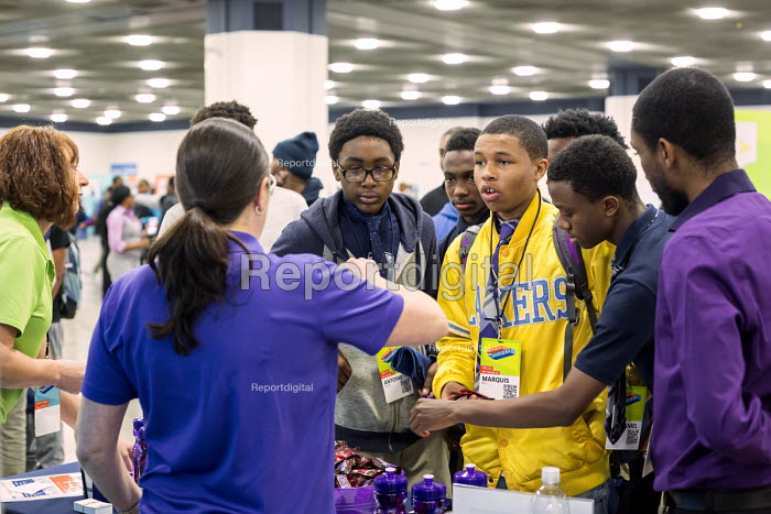 Detroit, Michigan, USA Young African American men talking to a Fedex recruiter, job fair sponsored by the nonprofit My Brothers Keeper - Jim West - 2016-11-14