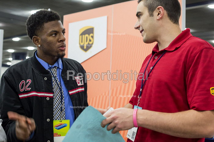 Detroit, Michigan: Young African American talking to a UPS recruiter, job fair sponsored by the nonprofit My Brother's Keeper - Jim West - 2016-11-14