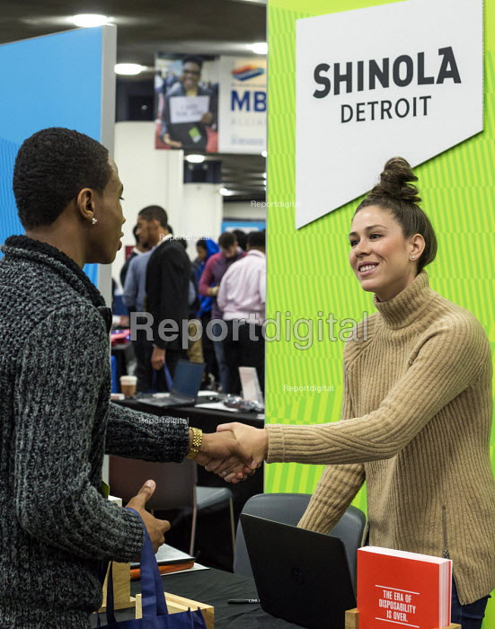 Detroit, Michigan: Young African American talking to a recruiter from Shinola, a maker of watches and leather goods, job fair sponsored by the nonprofit My Brother's Keeper - Jim West - 2016-11-14