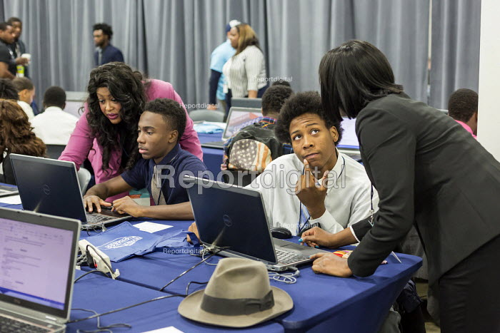 Detroit, Michigan. Young African American man getting help in preparing his CV at a job fair sponsored by the nonprofit My Brother's Keeper - Jim West - 2016-11-14