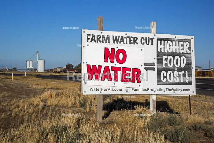 Buttonwillow, California, sign on a farm equating water shortages with higher food prices, New groundwater regulations will result in hundreds of thousands of acres of farmland taken out of production, San Joaquin Valley - Jim West - 2016-06-24