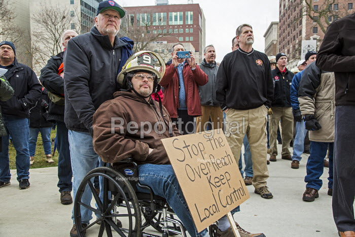 Lansing, Michigan USA Firefighters protest against austerity cuts to retirement and health benefits. The bills were withdrawn by the Republican until the 2017 legislative session - Jim West - 2016-12-06