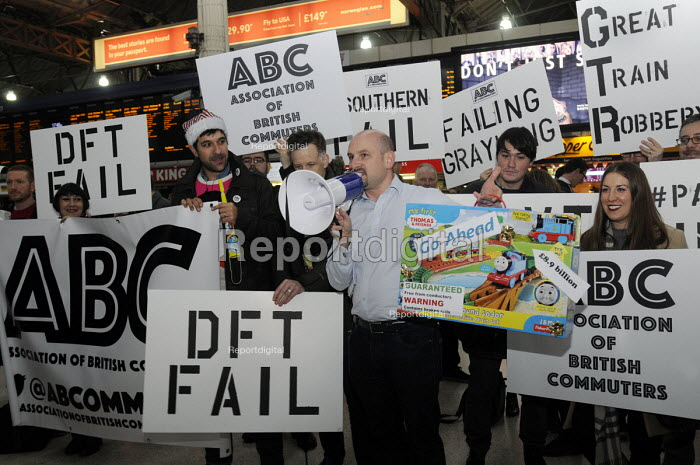 Rail passengers from the Association of British Commuters protest at Victoria Station against the crisis in transport provision at Southern Rail leading to terrible travelling conditions for customers and a dispute with the rail unions ASLEF & RMT - Stefano Cagnoni - 2016-12-15