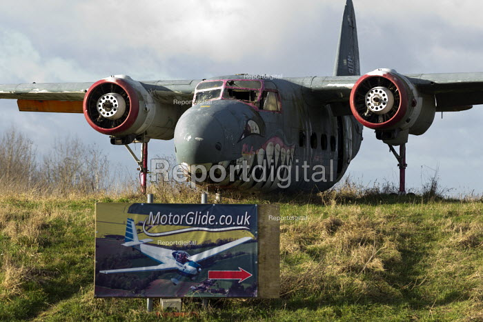 1952 Sea Prince aircraft wreck at the enternce to Long Marston Airfield, to be a Garden Village housing development, Warwickshire. Flying lessons in gliders sign - John Harris - 2017-01-04