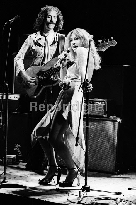 Hugh Fraser as Peyote on bass guitar and Helen Mirren singing as Maggie Frisby in Teeth 'N' Smiles, written and directed by David Hare, Royal Court Theatre, London, 1975 - Chris Davies - 1975-09-02