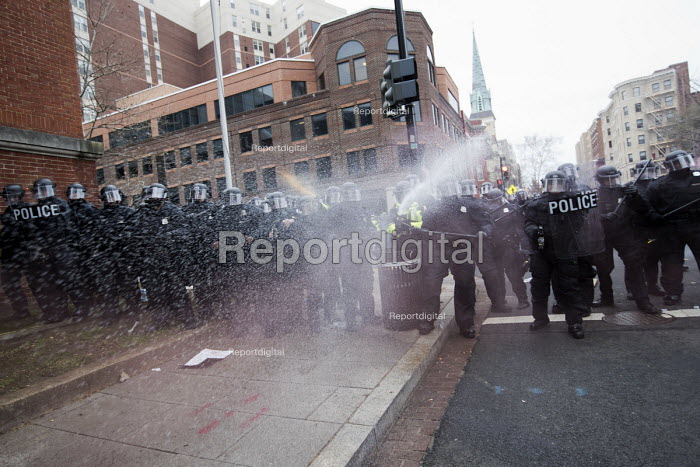 Riot police using CS gas. Anti Trump protests on Inauguration Day as Donald Trump takes office as President of USA, Washington DC - Jess Hurd - 2017-01-20