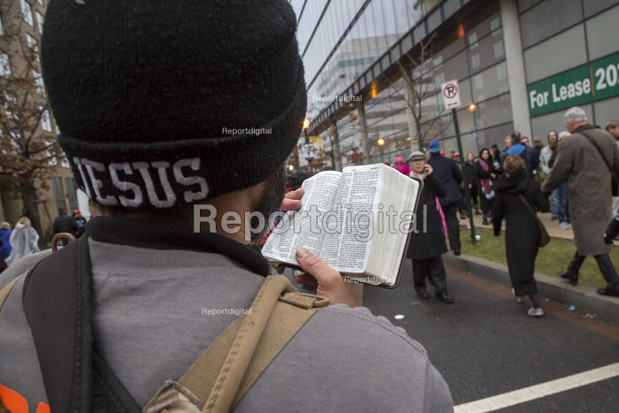 Washington, DC, Street preacher preaching from the Bible to people walking towards the inaugural ceremony for President Donald Trump - Jim West - 2017-01-20