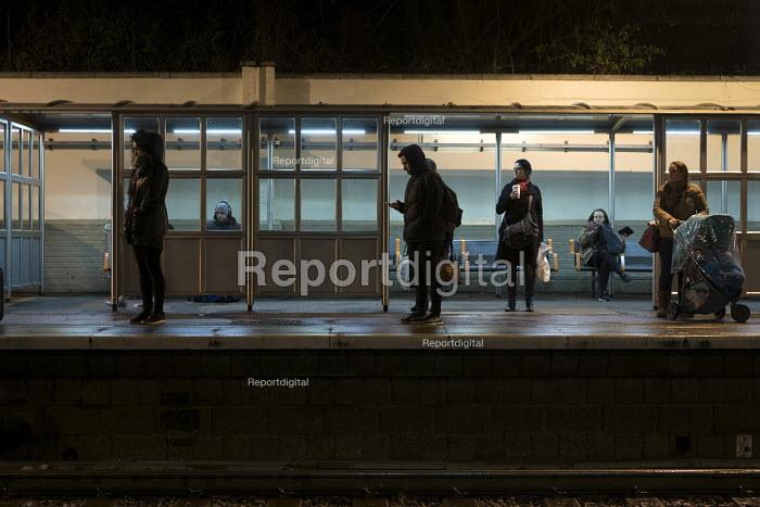 Passengers wait on Hampstead Heath Overground station platform after dark, London - Philip Wolmuth - 2017-02-03