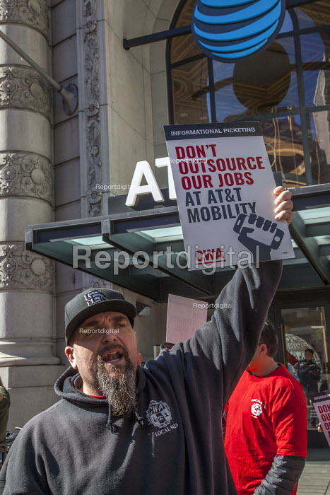San Francisco, USA, workers at AT&T Mobility protest at the unwillingness of the company to agree a new union contract. Members of CWA in front of the AT&T Mobility office - David Bacon - 2017-02-11