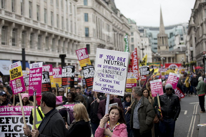 Stand up to Racism protest, UN Anti Racism Day, London. Desmond Tutu quote: If you are neutral in situations of injustice you have chosen the side of the oppressors - Jess Hurd - 2017-03-18