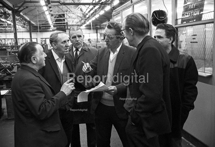 Workers occupying CAV Lucas factory Fazakerley, Liverpool 1972 against closure and redundancies as Lucas expand into Europe. Shop stewards discussing the rosters - Martin Mayer - 1972-10-14