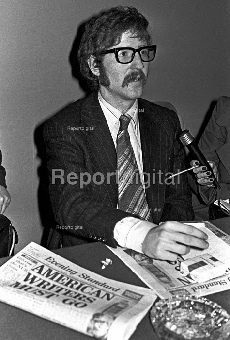 Mark Hosenball, facing deportation together with former CIA operative Philip Agee for revealing state secrets, at a press conference,with copy of Evening Standard supporting the actions of the state, headline American Writers Must Go - NLA - 1977-02-16