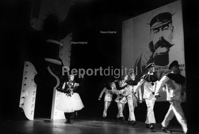 Actor Myvanwy Jenn waves goodbye to soldiers, Theatre Workshop production of Oh What A Lovely War! directed by Joan Littlewood, Theatre Royal Stratford East 1963 - Romano Cagnoni - 1963-03-19