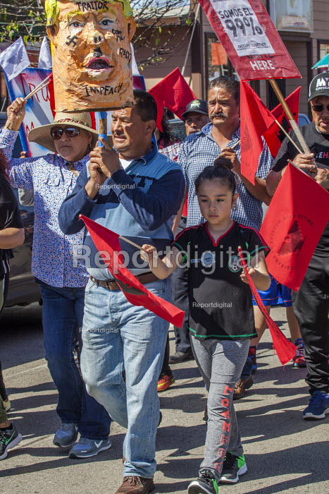 Salinas, Californi, USA Migrant farm workers celebrate Cesar Chavez Day with a Resist Trump march. Protest against anti immmigrant actions and statements by President Donald Trump. Organized by the UFW union - David Bacon - 2017-04-02