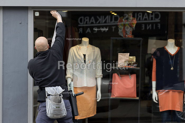 Window cleaners cleaning a shop window, Stratford-upon-Avon, Warwickshire - John Harris - 2017-04-07