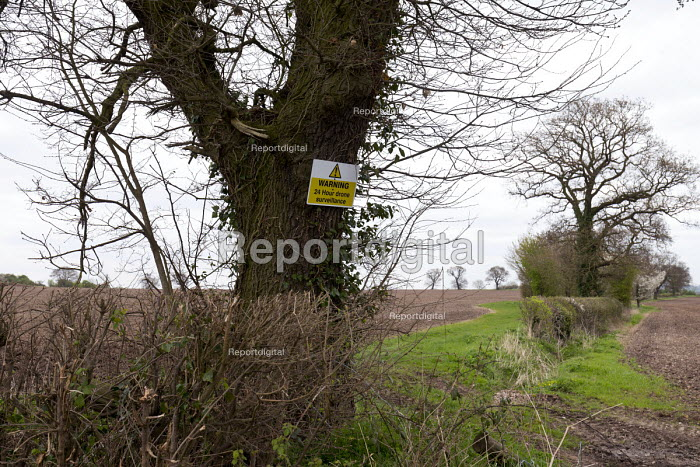 Sign warning of 24 hour drone surveillance over a farm, Warwickshire - John Harris - 2017-04-07