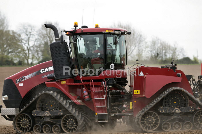 Farmer planting spring wheat with a tracked tractor Case IH Quadtrac 600 and Rapid seed drill, Warwickshire - John Harris - 2017-04-07