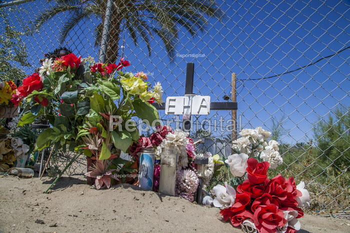 Coachella Valley, California. memorial to two palmeros killed when the platform they were working on came into contact with an electric power line. The crane was leaking oil and one worker was electrocuted while the other burned to death. Both were Mexican immigrants. Other workers built this memorial to them on the corner of 68th Avenue and Highway 86, in the Mexican tradition - David Bacon - 2017-04-03