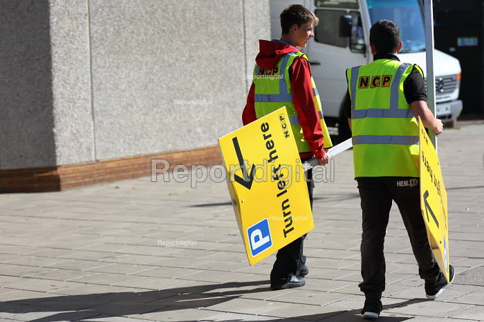 Young workers carrying a NCP car park sign Turn Left Here, TUC Conference Brighton - Jess Hurd - 2016-09-11