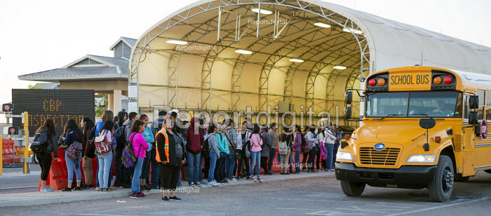 USA Mexican Border. Pupils from Palomas in Mexico Boarding buses in the morning to attend school in Columbus USA. All are US citizens, many living in Palomas with deported parents Others were born in Deming, which has the closest hospital to Palomas - Jim West - 2017-04-13
