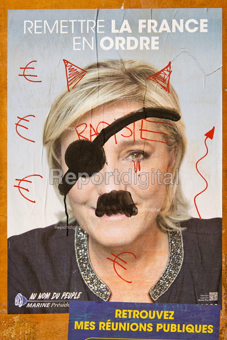 Electoral billboards. Vandalized poster of Marine Le Pen, National Front (FN) presidential election candidate, Grenoble, France - Francois Henry - 2017-04-11