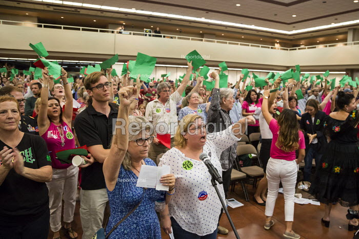 Mesa, Arizona, USA Constituents who support the Affordable Care Act argue with Republican Senator Jeff Flake at a town hall meeting. Many oppose a Mexican border wall. Audience members held up green paper to show agreement with a speaker. - Jim West - 2017-04-13