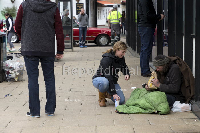 Passerby giving homeless man fastfood from McDonald's, Stratford upon Avon, Warwickshire - John Harris - 2017-04-30