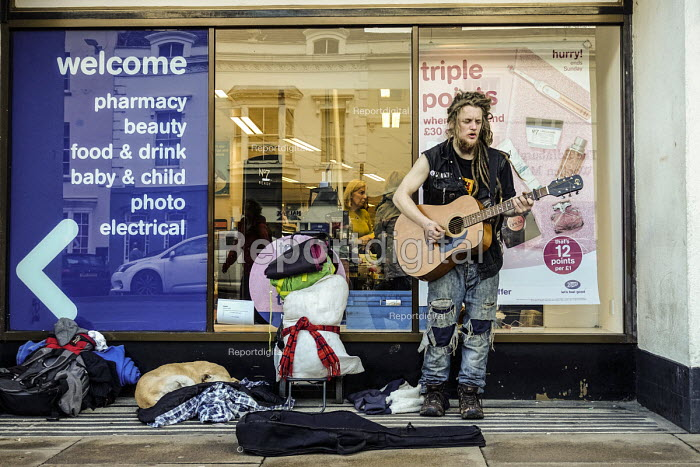 Homeless youth on the street busking, Stratford upon Avon, Warwickshire - John Harris - 2017-04-01