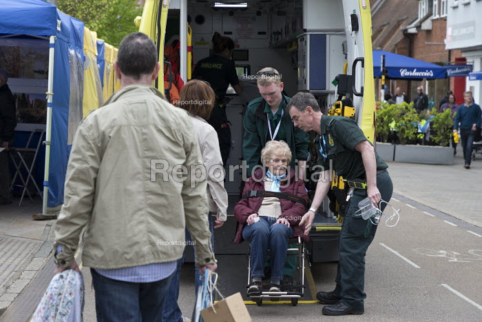 Paramedics loading an elderly woman into an ambulance - John Harris - 2017-04-30
