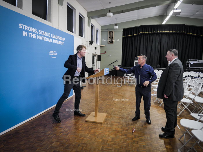 Conservative supporters line up to posing for photograhs in front of the stage set after Theresa May speech, General election campaign, Linskill Centre, North Shields - Mark Pinder - 2017-05-12