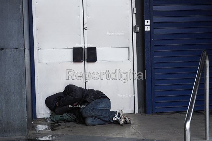 Homeless man sleeping in the doorway of an closed bank, Newcastle Upon Tyne - Mark Pinder - 2017-04-19