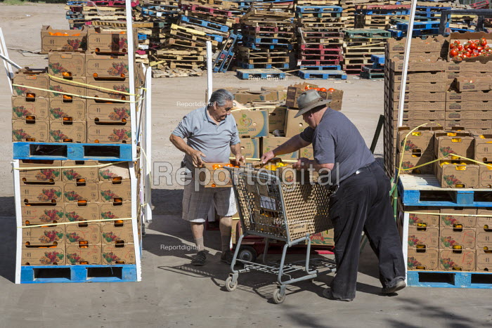 Nogales, Arizona, USA Nonprofit organizations from Arizona and Sonora, Mexico collect produce food from the Borderlands Food Bank. It distributes 30 to 40 million pounds of produce each year that would otherwise end up in landfill - Jim West - 2017-04-17