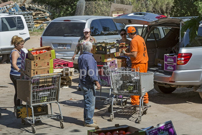 Nogales, Arizona, Prisoners working at the Borderlands Food Bank warehouse. It distributes 30 to 40 million pounds of produce each year that would otherwise end up in landfill - Jim West - 2017-04-19