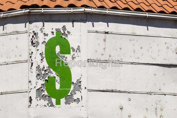 Detroit, Michigan Peeling paint and a dollar sign on a closed store. - Jim West - 2017-05-07