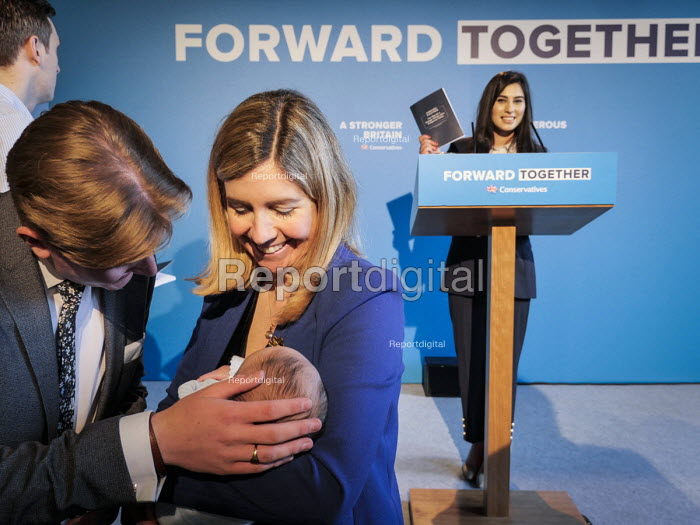 Conservative Party supporters line up to have their photographs taken on the stage set after Theresa May, Conservative Party manifesto launch, Dean Clough Mills, Halifax, Yorkshire, 2017 General Election campaign - Mark Pinder - 2017-05-18