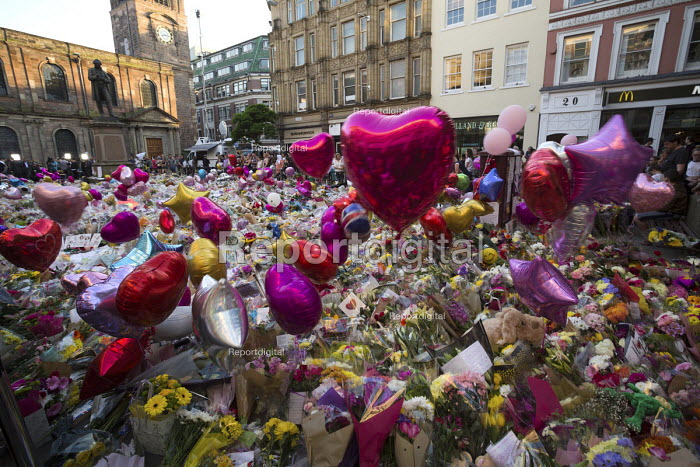 Flowers, candles, balloons and other tributes to the victims of the Manchester Arena terrorist bomb, St Anns Square, Manchester, UK - Paul Herrmann - 2017-05-26
