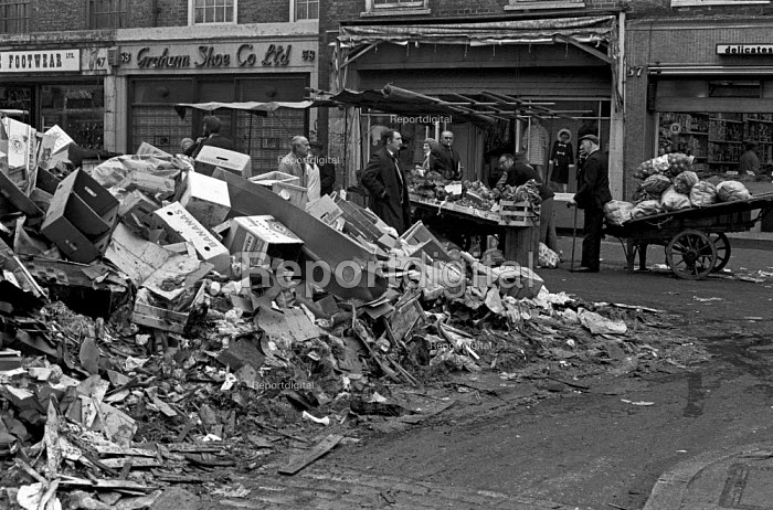 Council workers pay strike, with rubbish piled up at a street market, Tower Hamlets, East London 1970 - NLA - 1970-10-27