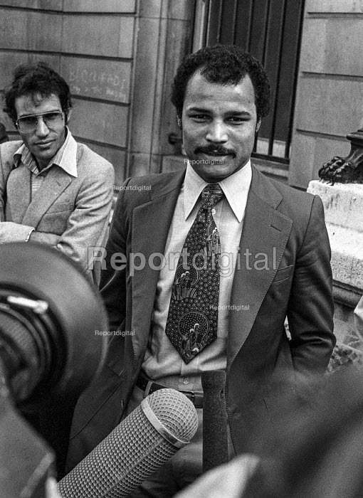 Boxer John Conteh speaking to TV journalist outside the High Court during his court case in a dispute over contract with the Boxing Board of Control, London 1979 - NLA - 1979-09-06