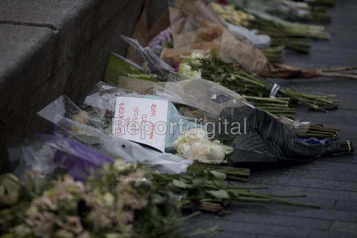 Floral tributes at a Vigil to honour victims of the London Bridge terrorist attack, City Hall, Potters Fields Park, London. - Jess Hurd - 2017-06-05