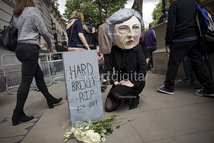 Anti Hard Brexit RIP protest as Theresa May leaves No 10 Downing Street to have an audience with the Queen after the General Election Hung Parliament result, London - Jess Hurd - 2017-06-09