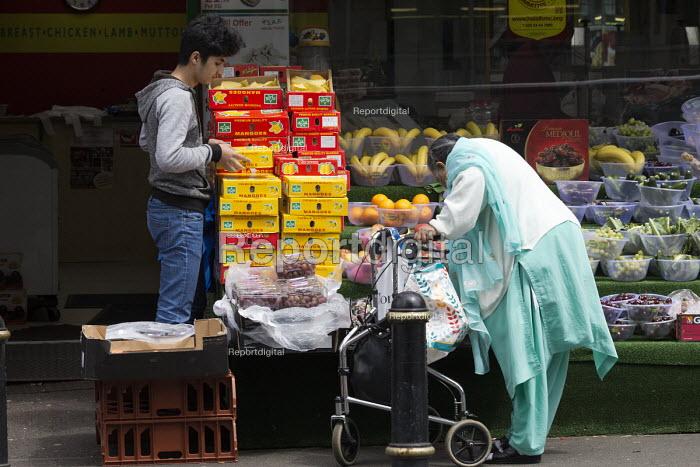 Shopworker serving a customer in a fruit and vegitable shop, Sparkbrook, Birmingham - John Harris - 2017-06-09