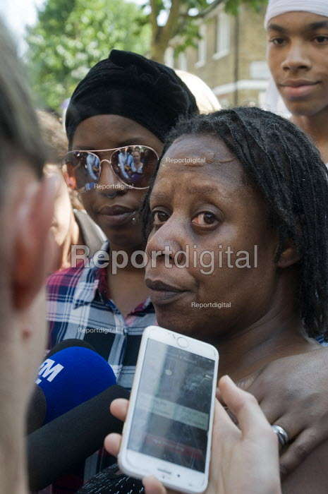 Grenfell Tower Fire. Family and friends support Aalya Moses a resident on the fourth floor of Grenfell Tower as she tells news reporters how she made her escape from the burning building which claimed the lives of many of her friends and neighbours - Stefano Cagnoni - 2017-06-14