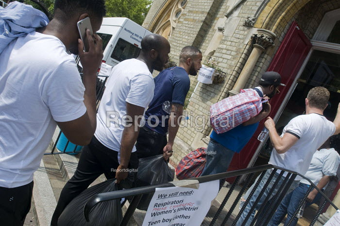 Grenfell Tower Fire. Local residents bringing donations to Notting Hill Methodist Church one of the Relief Centres set up just a few hundred metres from Grenfell Tower to help victims of the disaster many of whom lost everything they own from their homes in the fire that engulfed the tower block overnight - Stefano Cagnoni - 2017-06-14