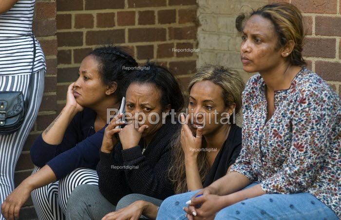 Grenfell Tower Fire. Anxious local women waiting opposite the makeshift evacuation centre at Rugby Portobello Trust for news of victims of the fire that engulfed the West London tower block overnight - Stefano Cagnoni - 2017-06-14