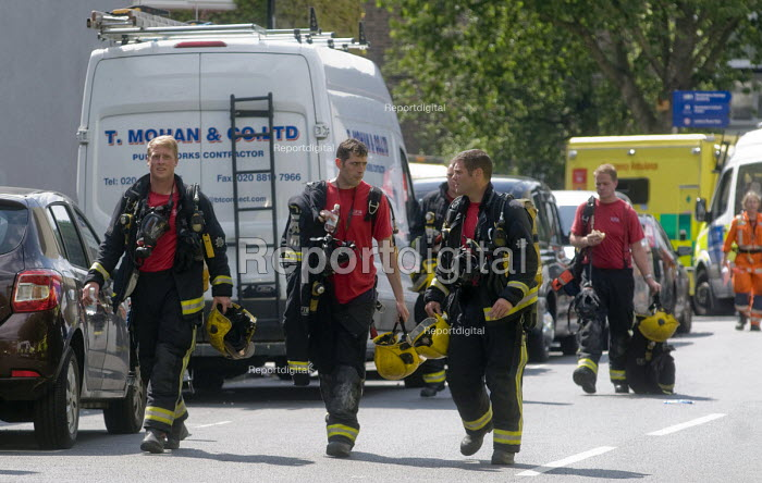 Grenfell Tower Fire. Firefighters leaving their shift on the afternoon after the overnight fire at Grenfell Tower which caused the loss of many lives - Stefano Cagnoni - 2017-06-14