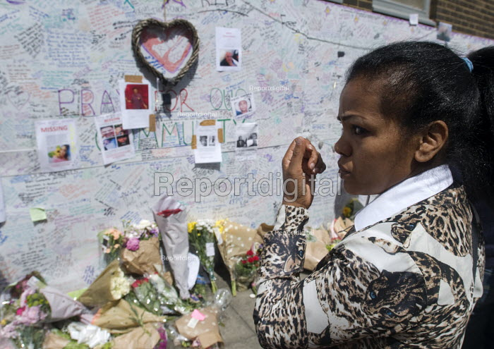 Woman in tears beside the Wall of condolence a few hundred metres from the Grenfell Tower fire filled with messages of love and solidarity in memory of the victims of the tragedy, London - Stefano Cagnoni - 2017-06-16